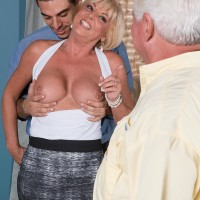 Fair-haired grannie Scarlet Andrews exposing hefty boobies before cuckold husband
