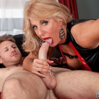 Gangly yellow-haired granny Phoenix Skye giving gigantic penis handjob and blowjob in heels