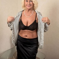 Golden-haired grandmother Regi letting floppy free from brassiere before grease rubdown from massagist