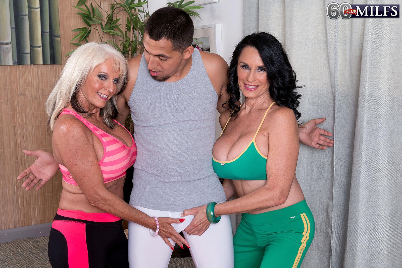 Grandma adult flick starlets Sally D'Angelo and Rita Daniels press large breasts together in Threeway