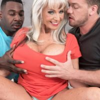 Foxy 60 plus MILF Sally D'Angelo sucks on a big black dick and a white one as well