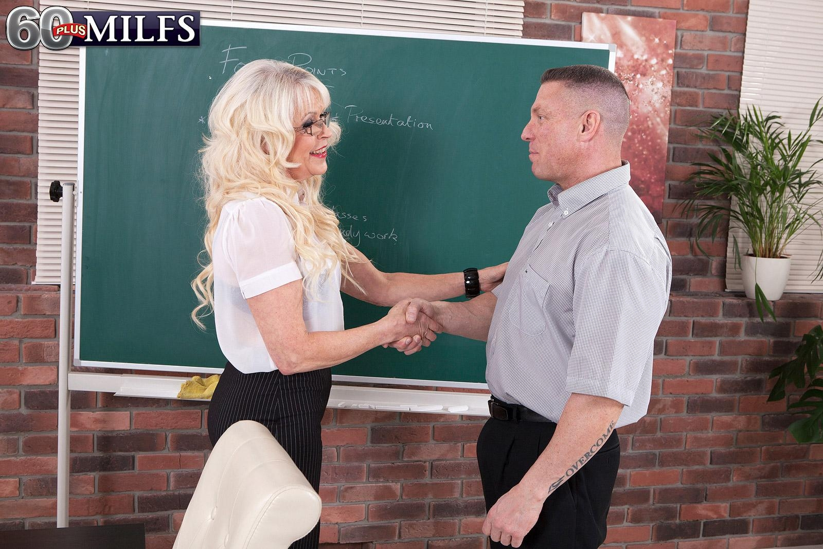 Gorgeous experienced professor Gal S tempts a male student in a black mini-skirt with her glasses on
