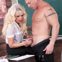 Wonderful aged teacher Dame S tempts a male student in an ebony micro-skirt and glasses