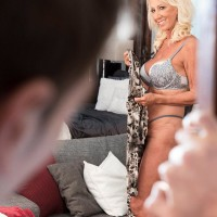 Hot over 60 MILF Madison Milstar tempts a junior dude in her brassiere and panties