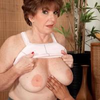 Huge-boobed Sixty plus MILF Bea Cummins unsheathing huge titties in spandex pants and g-string underwear