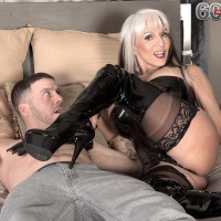 Huge boobed Sixty plus MILF Sally D'Angelo jerks a prick in latex boots and black corset
