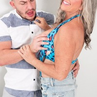 Jaw-dropping Sixty plus MILF Silva Foxx tempts a junior dude by showcasing her juggs in a denim skirt