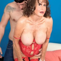 Lingerie clad brown-haired grannie Jacqueline Jolie unveiling massive breasts for nipple licking