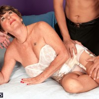 Lingerie wearing over 60 MILF Bea Cummins jacking off monster-sized peckers in MMF three way