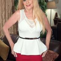 Mature light-haired lady Charlie has her massive titties unsheathed by younger boy in a crimson micro-skirt
