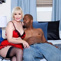 Nylon and lingerie wearing grandmother Lola Lee delivering enormous ebony knob BLOWJOBS with hefty boobs out