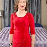 Nylons and high heel garmented granny Mona readying for sex with junior stud