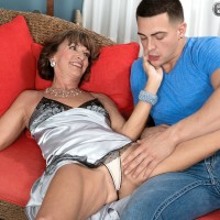 Older amateur over Sixty Sydni Lane unsheathing floppy funbags from lingerie before sex