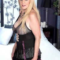 Over 60 blonde MILF letting out enormous natural funbags in ripped stockings and long boots