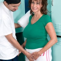 Over 60 MILF Jacqueline Jolie demonstrating bum in cut-offs while unveiling giant experienced juggs