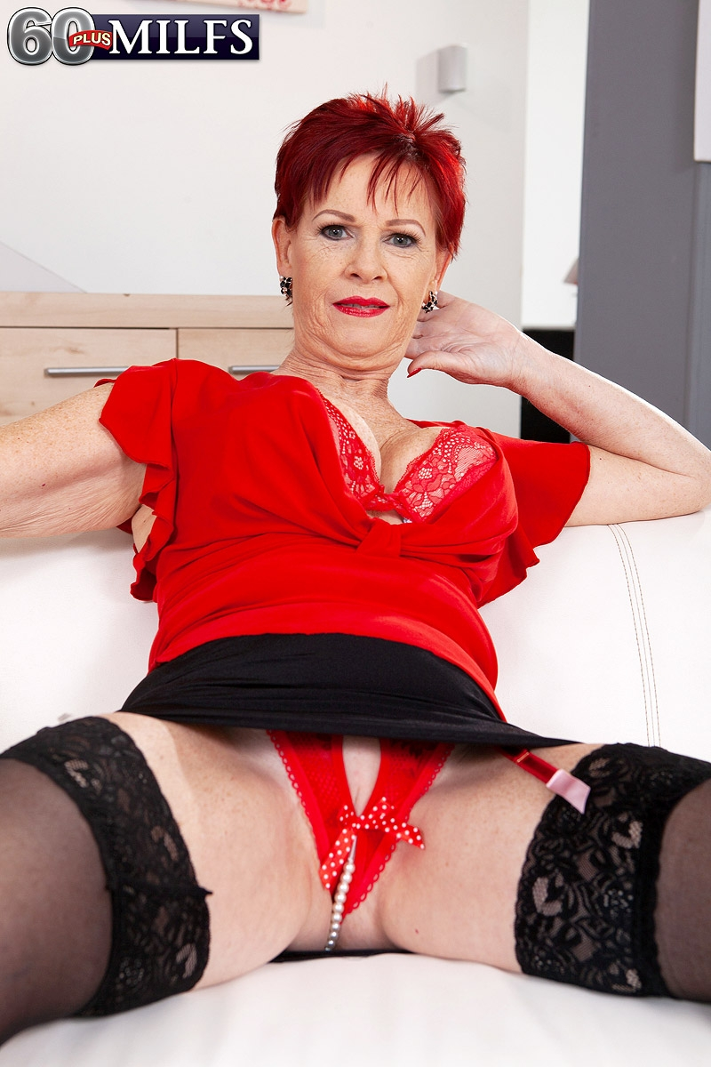 Over Sixty redhead Caroline Hamsel plays with her boobs while clad in crotchless underwear