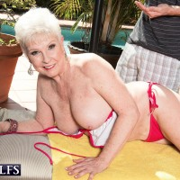 Over Sixty grannie Jewel whipping out immense boobies from bathing suit before doggy screwing