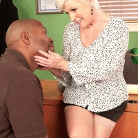 Over Sixty MILF uncovering gigantic grandmother juggs before interracial sex in office with BIG BLACK COCK