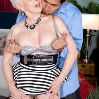 Over Sixty MILF X-rated film star Jewel having large tits freed from dress in tights and pumps