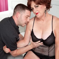Redhead grandma Gabriella LaMay pulling out enormous titties and erect nips from bodystocking