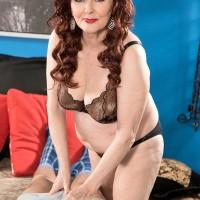 Redheaded 60 plus MILF prostitute Katherine Merlot giving massive sausage handjob and blow job