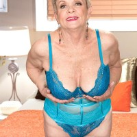 Short haired 60 plus MILF Lin Boyde revealing humungous boobies from lingerie in nylons