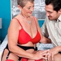 Short haired grandmother Joanne Price seducing junior man in stockings and garter