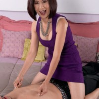 Smallish Oriental granny Kim Anh showing off milky lace panties to tempt younger guy