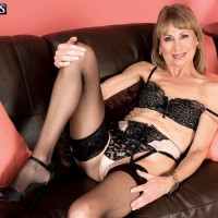 Stocking and lingerie garbed granny Patsy crossing and uncrossing gams in high heeled shoes