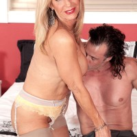 Stocking and lingerie garmented aged X-rated actress Phoenix Skye releasing giant tits and delivering rubdown