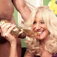 Stocking and lingerie wearing mature blonde Summeran Winters having interracial sex
