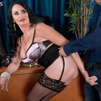 Stocking and mini-skirt outfitted granny Rita Daniels disrobing down to lingerie in work environment