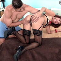 Stocking, garter and lingerie garbed Sixty plus MILF Sydni Lane whipping out bootie for sex acts