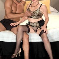 Stocking outfitted granny Bea Cummins delivering BIG EBONY COCK hand job in high-heeled shoes and girdle