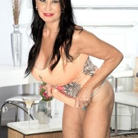 Top elderly XXX adult starlet Rita Daniels exposes her large titties and flashes her panties as well